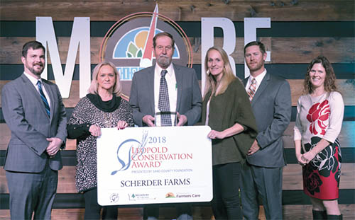 Scherder Farms of Frankford, Mo., received the 2018 Missouri Leopold Conservation Award on Jan. 10 at the 48th Missouri Governor's Conference on Agriculture. Pictured from left are Lance Irving, Sand County Foundation National Director for the Leopold Conservation Award; Sandy and John Scherder; their daughter and son-in-law, Holly and Curtis Delgman; and Missouri Farmers Care Executive Director Ashley McCarty.